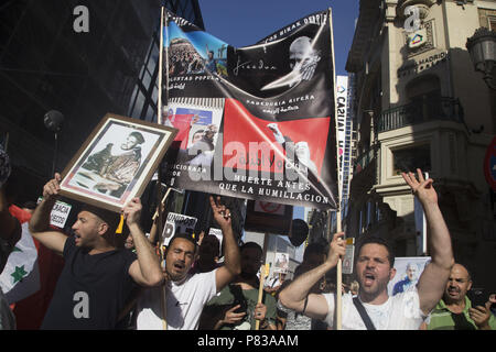 Madrid, Spain. 8th July, 2018. Protesters seen shouting while holding posters during the protest.Members of the Hirak in Madrid protest demanding the release of the political prisoners of the Rife who were caught during the revolts of 2017. Credit: Lito Lizana/SOPA Images/ZUMA Wire/Alamy Live News - Stock Photo