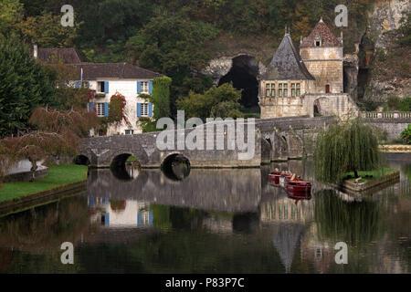 Old village reflected in Dordogne River, Brantome, France, Europe - Stock Photo