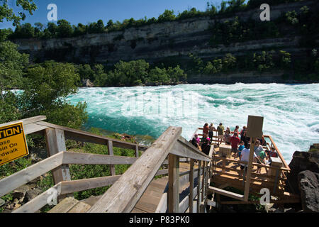 the Niagara River's Class 6 white-water rapids as seen from the White Water Walk attraction in the Niagara Gorge at Niagara Falls, Ontario, Canada - Stock Photo