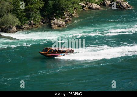 Whirlpool Jet Boat tour on the Niagara River in Niagara Gorge, Niagara Falls, Ontario, Canada - Stock Photo