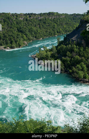 The white water rapids of the Niagara River at the river bend near the Whirpool Aero Car - Stock Photo