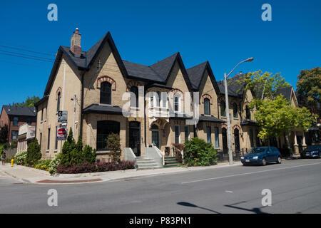 Quaint homes on neighborhood streets in Toronto, Ontario, Canada - Stock Photo