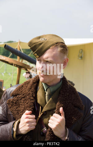 Re-enactor dressed in a world war one period Royal Flying Corp military uniform and leather flying jacket - Stock Photo