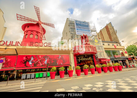 Paris, France - July 1, 2017: Boulevard de la Clichy and nightclub Moulin Rouge in Pigalle red lights district. Most popular historical theater and cabaret attraction of Paris.Tourism in Paris Capital - Stock Photo