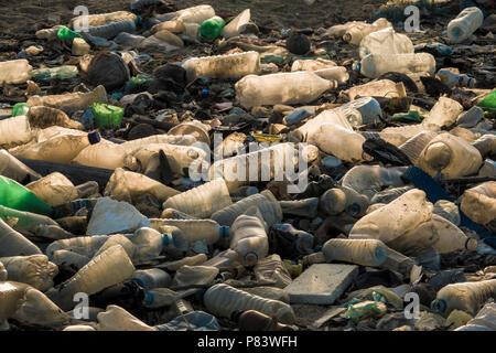 Empty single use plastic drink bottles and other trash on beach in Negombo, Sri Lanka - Stock Photo
