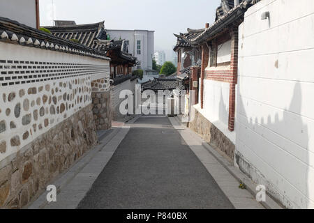 Traditional Korean style houses and architecture at Bukchon Hanok Village in Seoul, South Korea. - Stock Photo