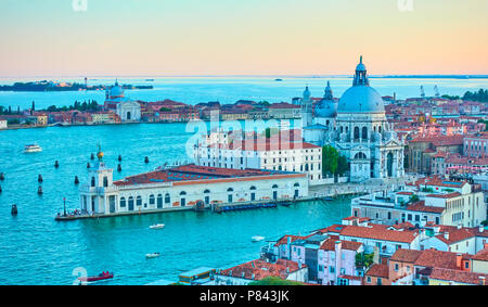 The Grand Canal and Santa Maria della Salute church in Venice in the early evening - panoramic view from above, Italy - Stock Photo