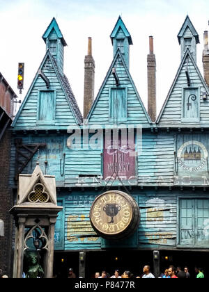 Universal Studios Harry Potter Wizarding World Storefront. The Hopping Pot is at the entrance..Rickety wooden blue slats make up rustic architecture. - Stock Photo
