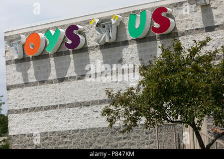 A Logo Sign Outside Of A Now Closed Toys R Us Retail Store In Des