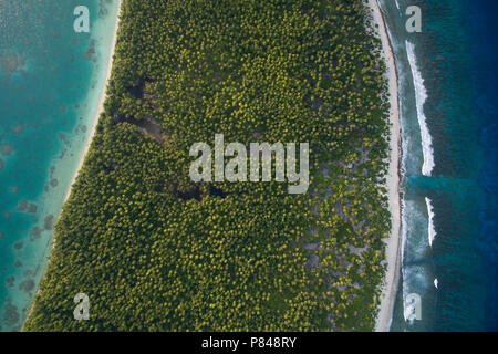 Aerial View of Orona Island, an uninhabited island in the Phoenix Islands, Kiribati. Visible is the lagoon, atoll and Pacific Ocean. - Stock Photo