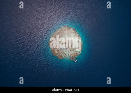 Aerial view of a Pearl Farm on Manihiki Lagoon, Cook Islands - Stock Photo