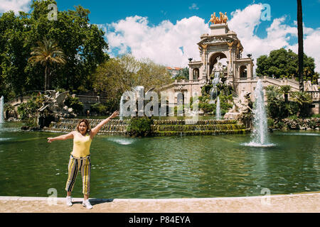 Barcelona, Spain - May 13, 2018: Young Happy Woman Posing For Photo Near Citadel Park In Sunny Day. - Stock Photo