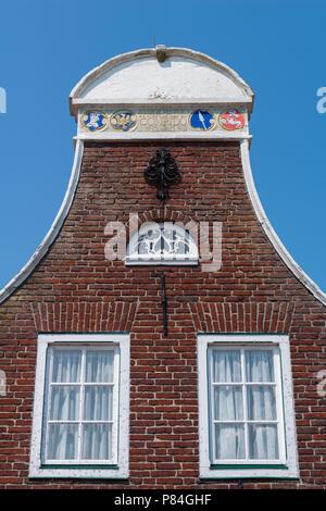 Special gables along the row of habour houses, Sielort Greetsiel, Krummhörn, North Sea, East Frisia, Lower Saxony, Germany - Stock Photo