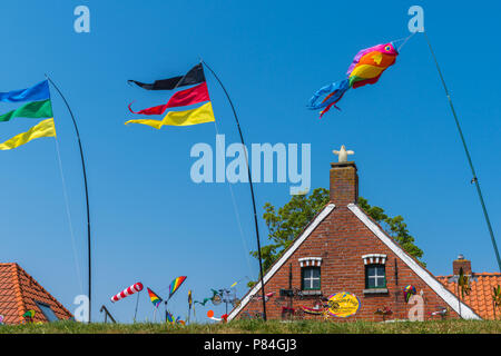 Special gables along the row of habour houses, Sielort Greetsiel, Krummhörn, North Sea, East Frisia, Lower Saxony, Germany - Stock Photo