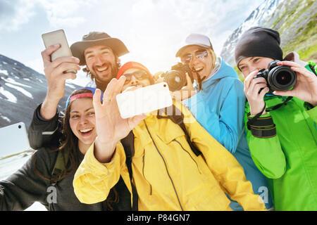 Group happy friends tourists photo selfie - Stock Photo