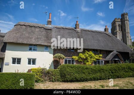 Ellesborough, UK. 6th July, 2018. A view of thatched cottages and Ellesborough parish church. - Stock Photo