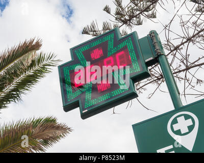 Tenerife, Canary Islands - Los Cristianos. Pharmacy sign with temperature display, 26°C. - Stock Photo