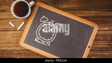 Clock time Education drawing on blackboard with coffee - Stock Photo