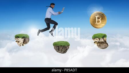 Businessman collecting bitcoins jumping on game platforms in sky holding laptop - Stock Photo
