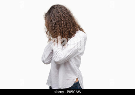 Beautiful young hispanic woman with sad expression covering face with hands while crying. Depression concept. - Stock Photo