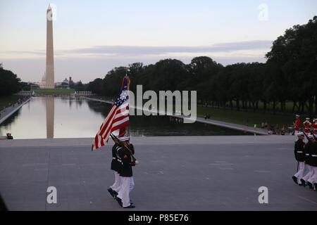 Marines with the U.S. Marine Corps Color Guard march the National Ensign and the U.S. Marine Corps Battle Colors across the parade deck during the Tuesday Sunset Parade at the Lincoln Memorial, Washington D.C. June 12, 2018, June 12, 2018. This year is the first year Barracks Marines are hosting Tuesday Sunset Parades at the Lincoln Memorial. The guest of honor for the parade was Secretary of the Interior Ryan Zinke and the hosting official was Robert D. Hogue, counsel for the commandant of the Marine Corps. () - Stock Photo