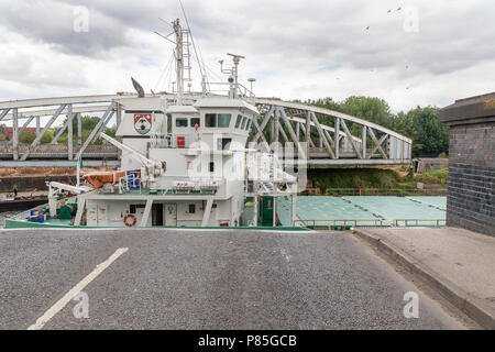 Arklow Rebel, a 13 year old General Cargo Ship from Ireland travels along the Manchester Ship Canal, through the open Swing Bridge at Stockton Heath - Stock Photo