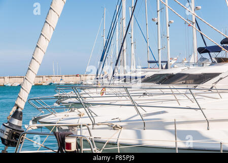 BENALMADENA, SPAIN - MAY 10, 2018 A beautiful marina with luxury yachts and motor boats in the tourist seaside town of Benalmadena - Stock Photo