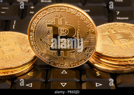 Bitcoin. Crypto currency Gold Bitcoin, BTC, Bit Coin. Macro shot of Bitcoin coins isolated on keyboard euro dollar top view - Stock Photo