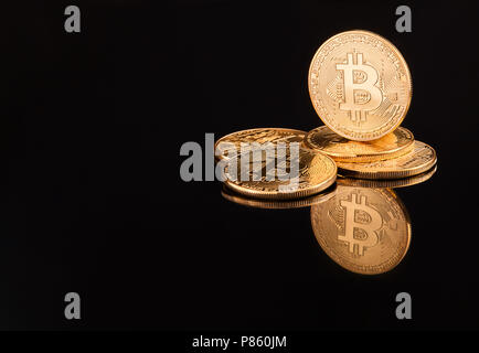 Bitcoin. Crypto currency Gold Bitcoin, BTC, Bit Coin. Macro shot of Bitcoin coins isolated on black background Blockchain technology, bit-coin mining  - Stock Photo