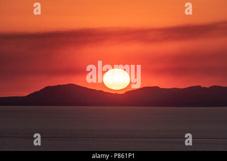 Sunset over the Llyn Peninsular - Stock Photo