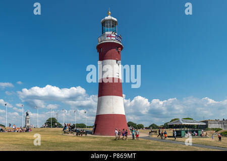 On yet another hot day in July, tourists wander around Smeaton's Tower on Plymouth Hoe seeking whatever shade they can find, as  temperatures in South - Stock Photo
