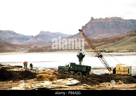 Dragline Basket and Claim Shell Bucket Are Used to Scoop Oil - Laden Debris from Log Boom on the San Juan River, 10 1972 - Stock Photo