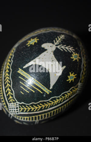 Pysanka is a Ukrainian Easter Egg decorated with traditional Ukrainian folk designs using a wax-resist method. - Stock Photo