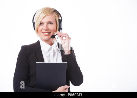 Smiling call center operator, blonde woman dressed in black jacket holding folder before white background with copyspace - Stock Photo
