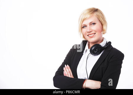 Smiling call center operator, blonde woman dressed in black jacket before white background with copyspace - Stock Photo