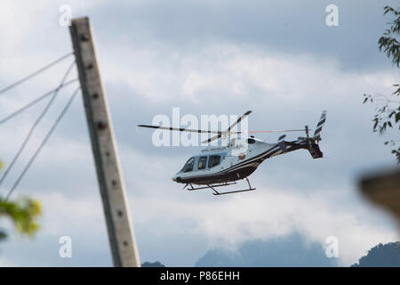 Mae Sai, Chiang Rai, Thailand. 9th July, 2018. A Royal Thai Police helicopter flies away to evacuate the 5th person from the Tham Luang cave to a hospital in Chiang Mai Credit: Adryel Talamantes/ZUMA Wire/Alamy Live News - Stock Photo