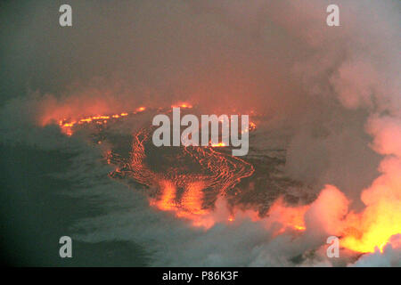 Hawaii. 9th July 2018. An early morning rain causes steam to rise from lava flows from the Kilauea volcano July 9, 2018 in Hawaii. The recent eruption continues destroying homes, forcing evacuations and spewing lava and poison gas on the Big Island of Hawaii. Credit: Planetpix/Alamy Live News - Stock Photo