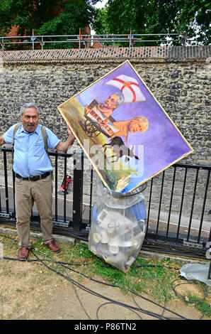 Westminster, London, UK. 10th July, 2018. Political cartoonist Kaya Mar puts one of his Brexit works in the rubbish bin on College Green, following the resignations of David Davis and Boris Johnson the day before. Credit: PjrFoto/Alamy Live News - Stock Photo