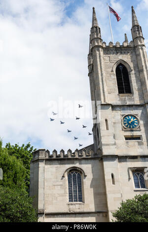 Windsor, UK. 10th July, 2018. Aircraft, including Britain's new F-35 Lightning stealth fighter jet flying for the first time in a public event, fly over the parish church of St John the Baptist in Windsor as part of a flypast to mark 100 years of the Royal Air Force. The RAF, the world's first independent air force, was formed on 1st April 1918 when the Royal Flying Corps and the Royal Naval Air Service were merged. Credit: Mark Kerrison/Alamy Live News - Stock Photo