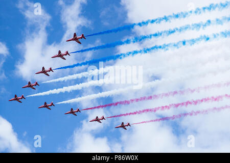 Windsor, UK. 10th July, 2018. The Red Arrows fly over Windsor as part of a flypast to mark 100 years of the Royal Air Force. The RAF, the world's first independent air force, was formed on 1st April 1918 when the Royal Flying Corps and the Royal Naval Air Service were merged. Credit: Mark Kerrison/Alamy Live News - Stock Photo