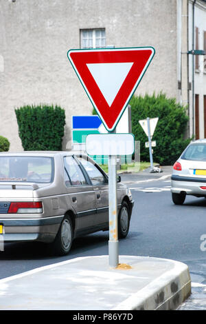 Yield Sign on road - Stock Photo