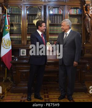 Mexican President Enrique Pena Nieto, left, meets with Mexican President-elect Andres Manuel Lopez Obrador at the National Palace July 3, 2018 in Mexico City, Mexico. Obrador and his leftist AMLO party, defeated the ruling PRI party in a landslide victory.  (Mexican Presidency via Planetpix) - Stock Photo