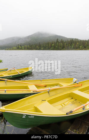 Fishing boats at lake Kesänkijärvi in Kolari, Lapland, Finland - Stock Photo