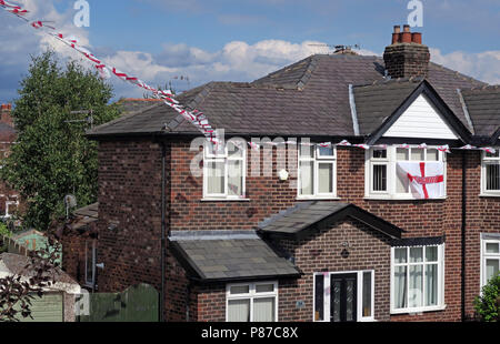 St George cross ed on white flags, flying in a residential street, Grappenhall, Warrington, Cheshire, North West England, UK - Stock Photo