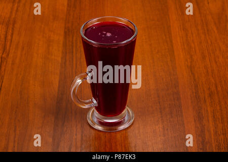 Black currant drink in the glass - Stock Photo