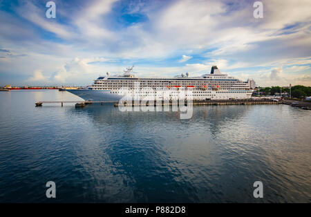 Luxury cruise ship docked in port. - Stock Photo