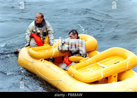 Astronauts Charles Conrad Jr. (left) and Richard F. Gordon Jr. (right), prime crew for the Gemini-11 spaceflight, practice water egress procedures in the Gulf of Mexico - Stock Photo