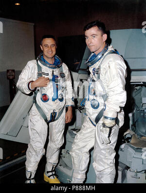 The Gemini-Titan 3 prime crew, astronauts Virgil I. Grissom (left), command pilot, and John W. Young, pilot, are shown during flight simulation test activity - Stock Photo