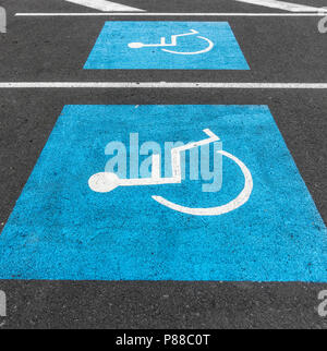 Disabled parking bay in supermarket car park - Stock Photo