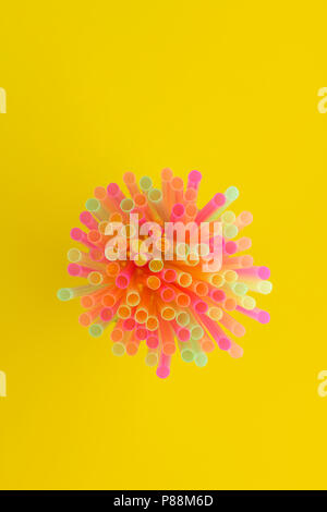 Creative view of drinking straws(neon colors) party on yellow background. Top view. - Stock Photo